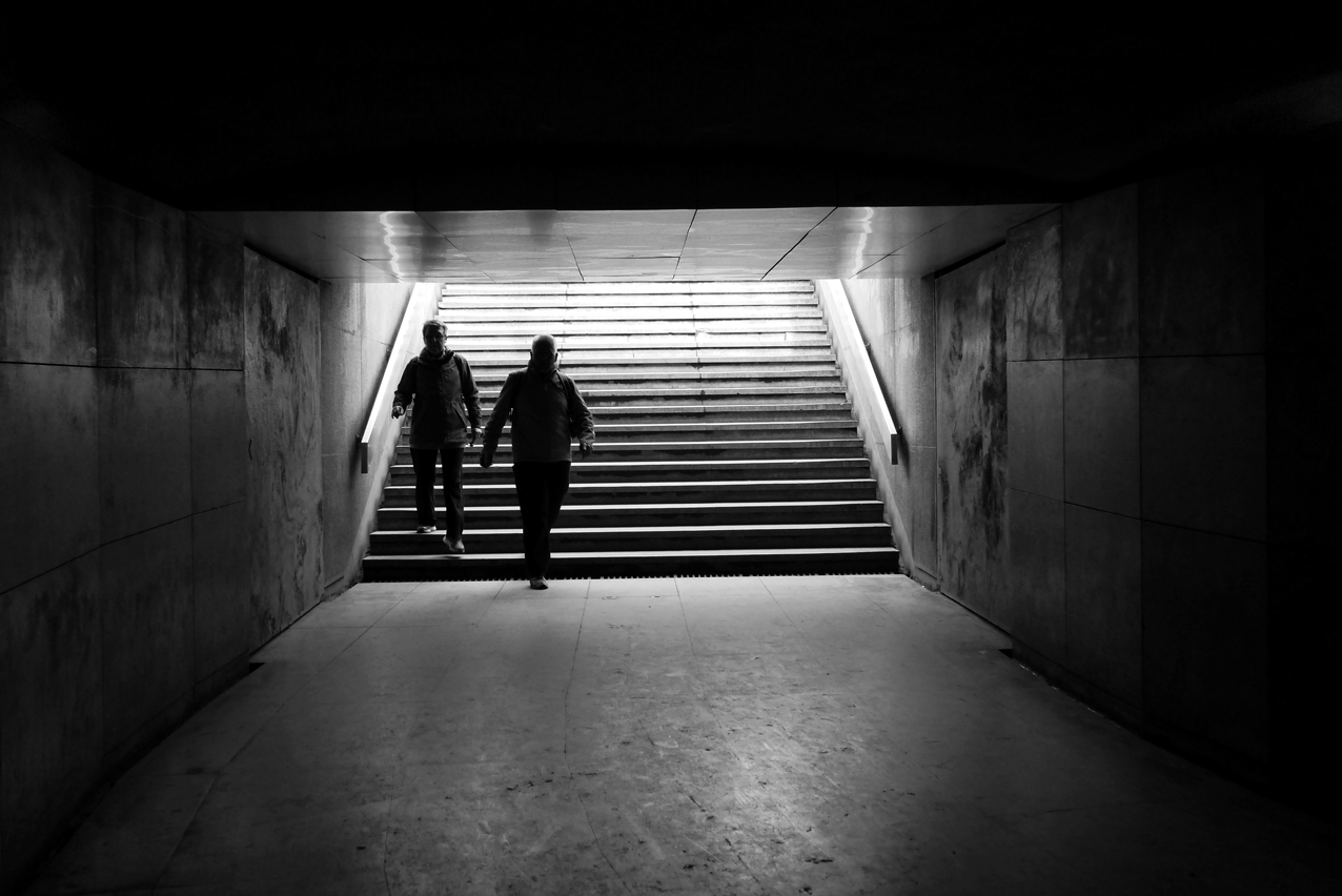 An underground passage in Paris, leading to and from the Arche de Triumph under the Place Charles de Gaulle. Street Photography in Paris.