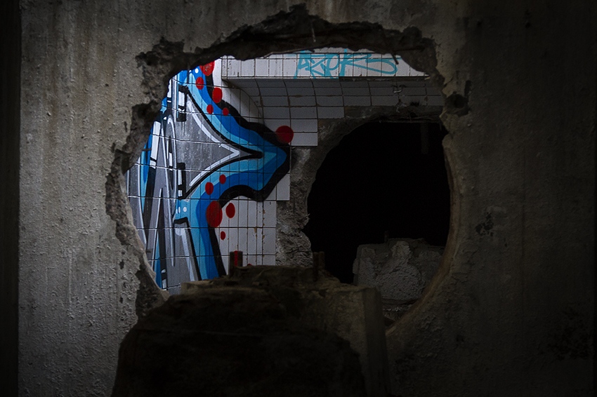 Graf in a hole - Urban Exploration Photography