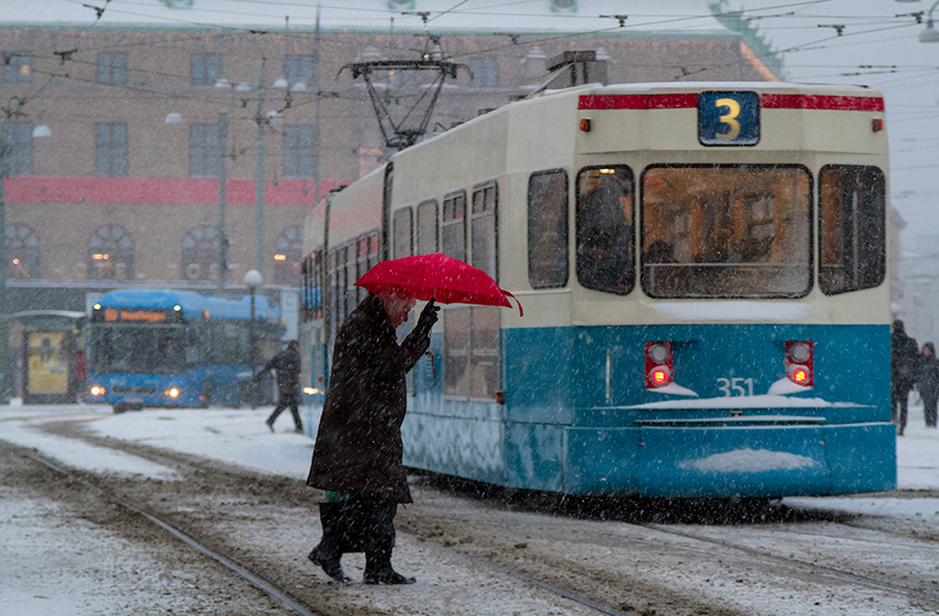 Drottningtorget in the snow - a red umbrella, Street Photography
