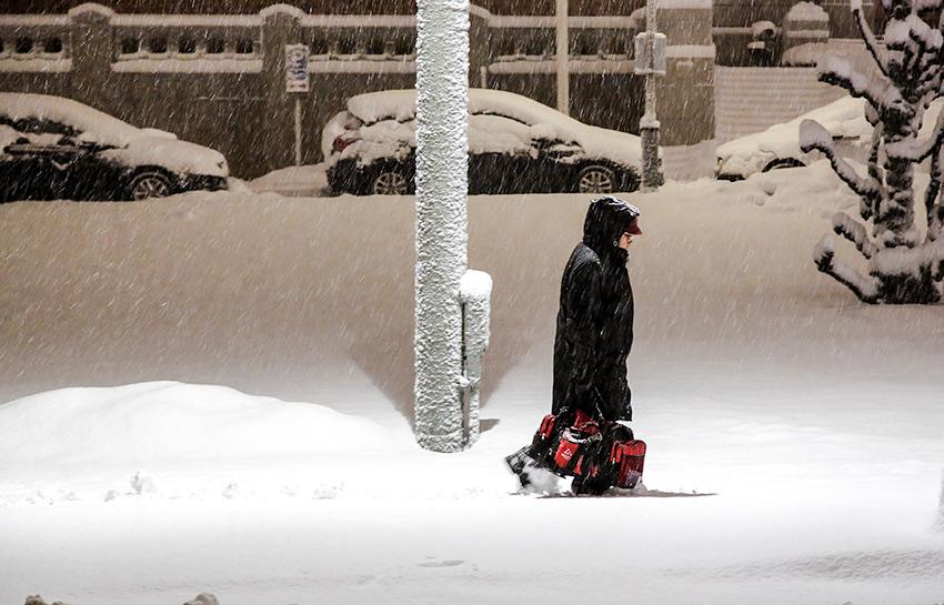A man walking thru the snow - Street Photography